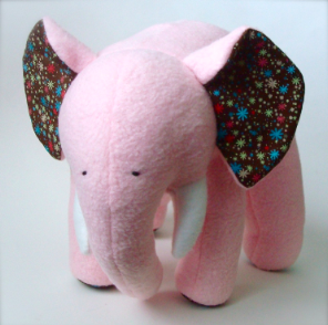 pink stuffed animal elephant with big ears of star